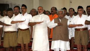 In this photograph taken on September 6, 2009, Chief Minister of the western Indian state of Gujarat Narendra Modi (3L) and former chief minister Keshubhai Patel (2R, front) gesture as they attend a Rashtriya Swayamsevak Sangh (RSS) gathering at Tria Mandir in Adalaj, some 20kms from Ahmedabad.