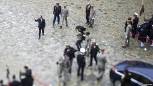 A picture taken with a tilt and shift lens shows French President Francois Hollande