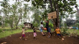Children playing basketball in the Philippines