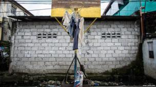 Clothes are hung out to dry at a basketball court in the slum area of Artex, Malabon Philippines.