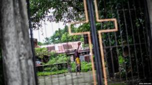 Children play at a basketball court inside the premises of a church in Samar, south of the Philippines