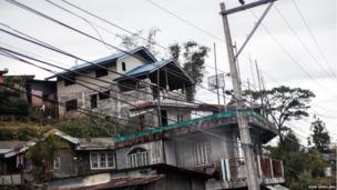 A basketball court is seen on a balcony of a home in Baguio City, province of Benguet, north of Metro Manila Philippines.