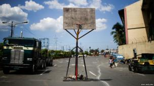 A basketball court in a street in Tondo,one of the most densely populated areas of Metro Manila, Philippines.
