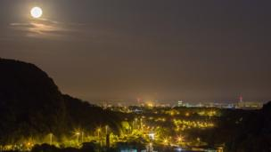 Moon rising over Cardiff. Pete Anning's photograph taken from Gwaelod-y-Garth