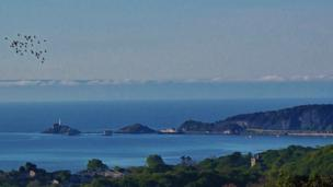 Richard Hammond from Killay, Swansea, captured this view of Mumbles head in Swansea Bay early in the morning at high tide