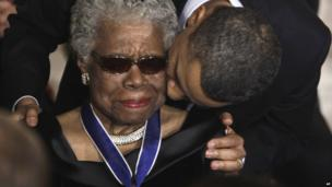 President Barack Obama kisses author and poet Maya Angelou after awarding her the 2010 Medal of Freedom