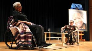 Maya Angelou, left, talks with Johnnetta Cole, director of the National Museum of African Art, at Maya Angelou's portrait unveiling at the Smithsonian's National Portrait Gallery in April 2014 in Washington, DC