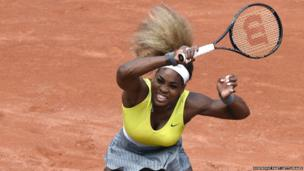 Serena Williams hits a return to Spain's Garbine Muguruza during their French tennis Open second round match at the Roland Garros stadium in Paris on 28 May 2014.
