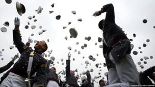 Cadets throw their hats in the air at the conclusion of the graduation ceremony at the US Military Academy at West Point, New York on 28 May 2014.