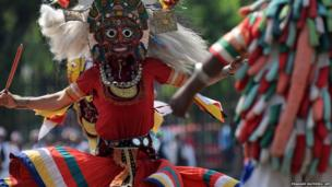 Masked dancers perform during Nepal's Republic Day celebrations in Kathmandu on 29 May 2014.