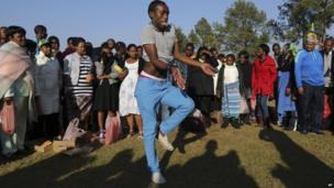 A man dances in Pretoria, South Africa, on 24 May 2014