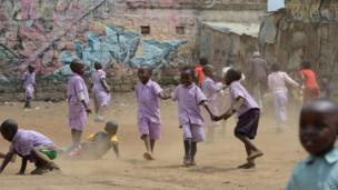 School children play on 28 May 2014 in a dusty field in Mathare, one of the poorest slums in Nairobi, Kenya