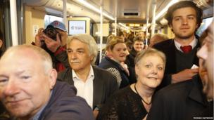 Passengers on first tram service