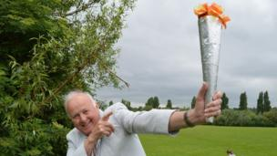 Tony Fox holding a home-made torch