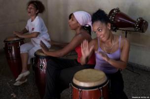 Adonay D' Armas (left), Wendy Garcia (centre) and Yilian Letamendi play the drums in Old Havana, Cuba