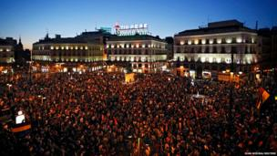People take part in an anti-monarchist demonstration at Madrid's landmark Puerta del Sol Square