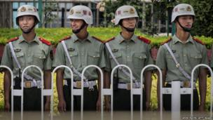 Chinese Paramilitary police stand guard near Tiananmen Square