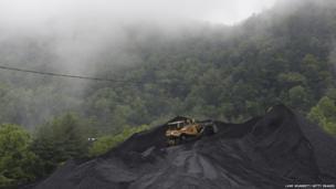 A bulldozer operates atop a coal mound at the CCI Energy Slones Branch Terminal in Shelbiana, Kentucky