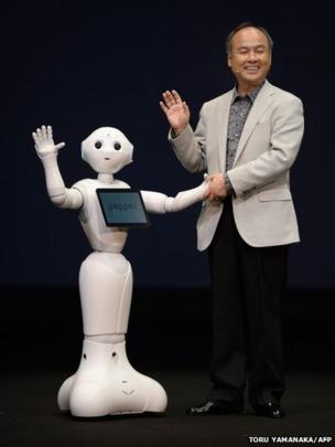 Masayoshi Son, President of Japan's mobile carrier SoftBank, introduces the humanoid robot Pepper