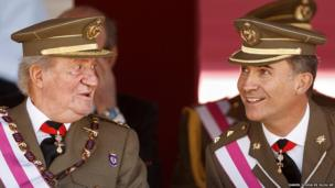 King Juan Carlos (left) and Crown Prince Felipe, attend a military ceremony in San Lorenzo de El Escorial, outside Madrid, Spain