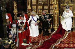 One of the Queen's pageboys faints in the House of Lords