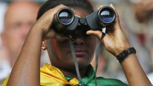 A Cameroonian football supporter looking through binoculars at a stadium in Moenchengladbach, Germany - Sunday 1 June 2014
