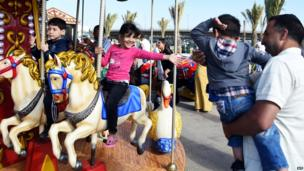 Children at a merry-go-round in Algiers, Algeria - Saturday 31 May 2014