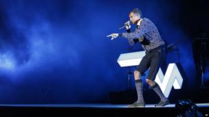 Singer-songwriter Paul Van Haver, known by his stage name Stromae, performs at a concert in knee-length socks in Rabat, Morocco - Monday 2 June 2014
