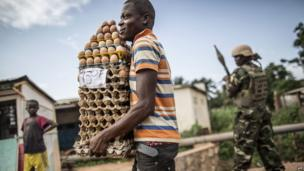 A vendor carrying trays of eggs in Bangui, CAR - Saturday 31 May 2014