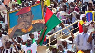 Opposition supporters at a rally holding a portrait of Burkina Faso's former President Thomas Sankara - Saturday 31 May 2014
