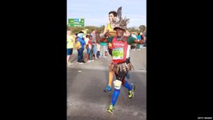A competitor wearing feathers taking part in the Comrades Marathon in South Africa - Sunday 1 June 2014