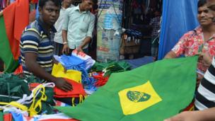 Dhaka market traders selling flags