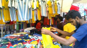 Brazil and Argentina shirts at a market stall in Dhaka