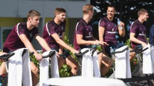 England players on exercise bikes