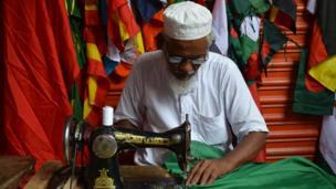 A tailor making a Brazil flag Dhaka