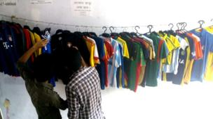 Bengali football fans shopping for shirts