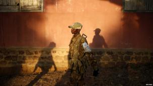 Seleka fighter walks in a village in the Central African Republic, close to the border of the Democratic Republic of Congo. 11 June 2014