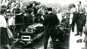 Crowds photographing train