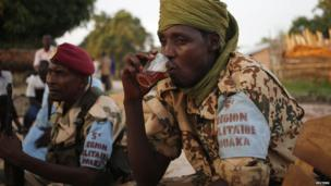 A Seleka fighter drinking tea, Central African Republic - Tuesday 10 June 2014