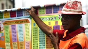 A vendor selling maths charts in Lagos, Nigeria- Tuesday 10 June 2014