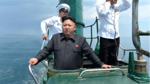 """This undated picture released from North Korea""""s official Korean Central News Agency (KCNA) on June 16, 2014 shows North Korean leader Kim Jong-Un (C) inspecting the submarine No. 748 of Korean People""""s Army (KPA) naval unit 167 led 7th regiment at an undisclosed location in North Korea"""