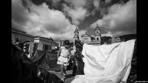 A girl on Plaza Bolivar in Bogota