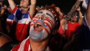 A US football fan celebrates his team's victory