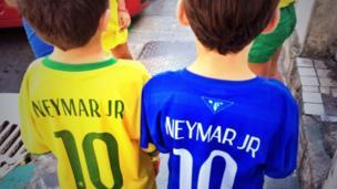 Two kids wearing Neymar shirts