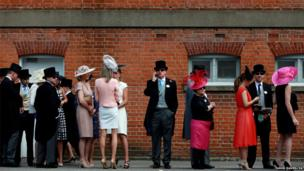 Racegoers queue up to get in to day one of Royal Ascot in Berkshire