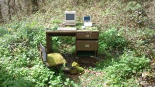 Computers on a desk in the woods