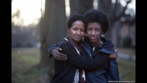 Naima, 36, with her son Teso, 14, outside their home in Atlanta, Georgia.