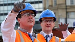 UK PM David Cameron (L) and Chancellor George Osborne tour building works at Manchester's Victoria Railway Station which is being upgraded on 23 June 2014 in Manchester, England.