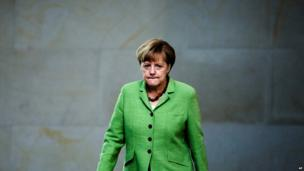German Chancellor Angela Merkel arrives for a debate about the budget plans for 2014 at the German parliament Bundestag in Berlin, on 24 June 2014.