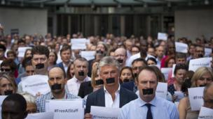 The BBC's Director of News and Current Affairs, James Harding, joins staff and colleagues from other news organisations in a one-minute silent protest outside New Broadcasting House against the seven-year jail terms given to three al-Jazeera journalists in Egypt on 24 June 2014 in London.